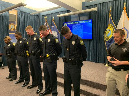 Curt praying for new officers